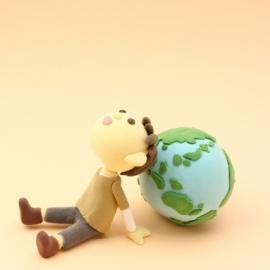 こどもが地球を守っているイメージ