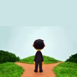 わかれ道に立つ男性の後ろ姿を表すクレーアート