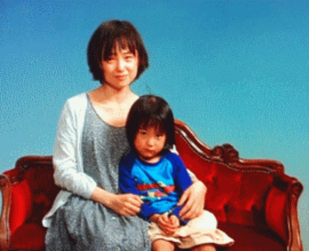 希和子と薫の二人の家族写真